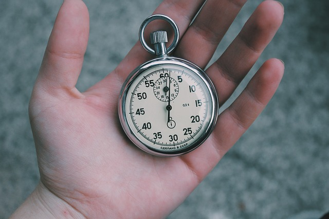 stopwatch in someone's hand