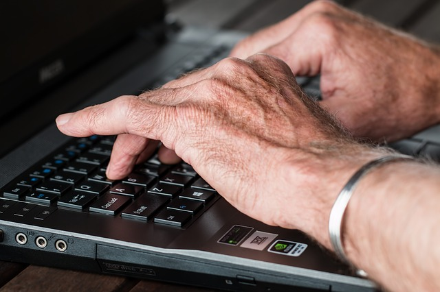 image of hands on a keyboard typing